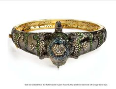 Tsavorite and Diamond bracelet with ornate turtle centerpiece.