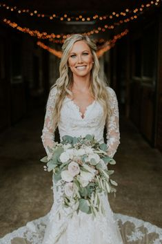 Neutral Wedding Flowers- Cascade bridal bouquet with muted pink, dusty rose, ivory flowers and eucalyptus greenery. Floral: Wildflowers LLC Photo: Jennifer Cody Weddings