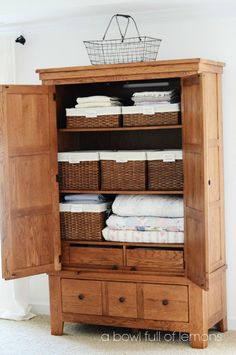 Linen closet organization - I really love this armoire: the drawers inside and out, plus the basket organization - would love to DIY a similar piece for fabric storage in the craft room.this would be better then the linen closet we have Linen Closet Organization, Basket Organization, Bathroom Organization, Wardrobe Storage, Storage Baskets, Bedroom Storage, Wardrobe Closet, Armoire Cabinet, Antique Armoire