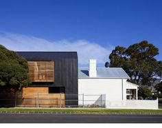 Black siding (prob anthra zinc) w/ cedar modern barn/farm house, metal roof aluminum/galvalume, gable