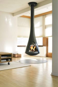 modern fireplaces, hanging fireplace design ideas for contemporary home interiors Suspended Fireplace, Floating Fireplace, Mounted Fireplace, Hanging Fireplace, Open Fireplace, Fireplace Design, Wood Burner, Contemporary Interior Design, Home And Living
