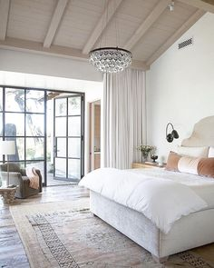 I like the idea of painting the walls light and the ceiling darker.  Could still do black window trim this way