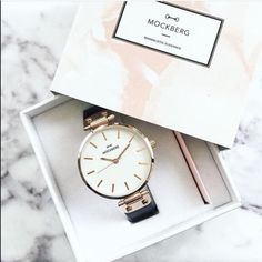 New Mockberg Black & Gold watch Gorgeous Mockberg Black and Gold wrist watch. Very flattering and fun to wear. Perfect addition to any outfit. Retail: $180. Brand new in box. Get this bargain before it's gone! Michael Kors Accessories Watches