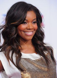Gabrielle Union showed off her peek-a-boo highlights at the NBA All-Star Game. The blond strands are mixed in beautifully with the rest of Gabrielle's dark tresses.