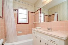 "We looked at Mary's retro kitchen transformation on Monday, but I held the bathroom for its own story — because, golly, doesn't the ""Grete"" wallpaper from Bradbury & Bradbury Art Wallpapers look fabulous in her original peachy pink bathroom? Photo viewing tip: Click on the photos in this and any other story, and the photos should …"