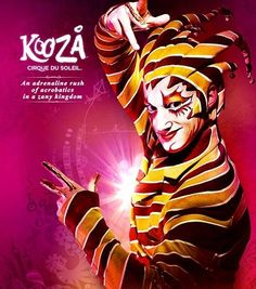 [Image: A color photograph of the Trickster character from the Cirque du Soleil show Kooza, dressed in a yellow white and deep red striped suit a headdress of a twisted parody of a jester's cap, and bright flamboyant makeup. They have flakes of gold. Virginia Beach Rentals, Portland, Trick Riding, Dark Fairytale, Night Circus, Clown Makeup, Big Top, Phoenix, Lion