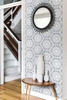 Hexagonal tile effect wallpaper pattern, with a central stylised flower motif.