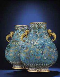 A LARGE PAIR OF CLOISONNE ENAMEL 'HUNDRED DEER' VASES, ZUN  QIANLONG PERIOD (1736-1795)