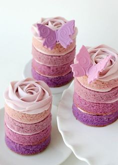 Purple ombré mini cakes. Make 4 sheet cakes. One of each hue (extra food coloring for darest) cut with circle biscuit cutter when cooled stack & ice!
