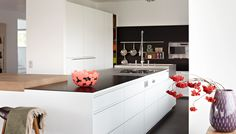 Floral accents pack a punch in this clean white kitchen completed by Design Center of the Americas. Kitchen Cabinet Design, Kitchen Decor, Kitchen Cabinets, Interior Design Magazine, Interior Design Inspiration, Villa, Higher Design, Beautiful Kitchens, Architecture