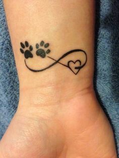 Infinity sign with black outline heart and 2 dog paw prints tattoo> left wrist