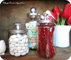 DIY Apothecary Jars: Parties For Pennies  These adorable apothecary jars are made from old spaghetti jars if you can believe it! Add a drawer knob and spray paint and voila! You have Apothecary jars or next to nothing. I love these. They would work in any room in the house.