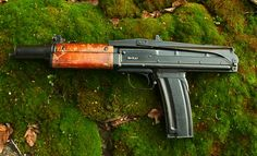 The AO-46 was a gas-operated 5.45x39mm caliber, compact carbine/assault rifle prototype. It features a folding stock and the trigger is located just in front of the magazine, which doubles as pistol grip. In order to minimize the length of the gun, gas for automatic operation was collected not out of the barrel, but directly from the flash suppressor in the muzzle. Designed by Peter Andreevich Tkachev in 1969.