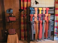 Display idea for scarves http://memphisweaver.files.wordpress.com/2010/11/scarf-and-purse-display-at-home-show1.jpg