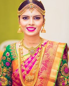 South Indian bride. Gold Indian bridal jewelry.Temple jewelry. Jhumkis.Pink and green silk kanchipuram sari. Braid with fresh flowers. Tamil bride. Telugu bride. Kannada bride. Hindu bride. Malayalee bride.Kerala bride.South Indian wedding. Pinterest: @deepa8