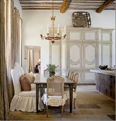 This French Country dining room with its slipcovers and rustic elegance is a glorious balance of humility and decadence. See more