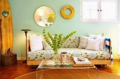 http://www.homedesignlove.com/2014/10/colorful-and-cheering-summer-living-room.html
