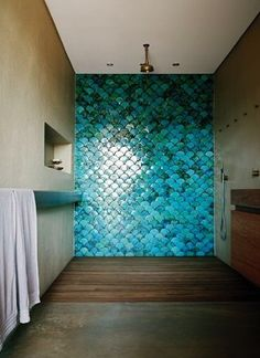 Modern bathroom with grey concrete floors and walls.  LOVE the turquoise fish scale tiles in the walk-in shower. by nuele