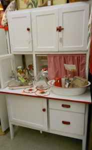 Some day I want to have a Hoosier cabinet. This one is cute.