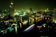 Bangkok at night (Chao Phraya River with State Tower to the left).