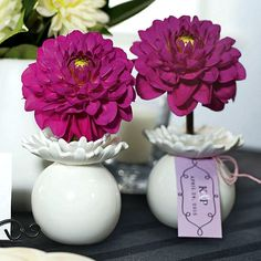 How cute are these bud vases.  The are shaped like a flower petal.  Would look so cute next to larger centerpieces.