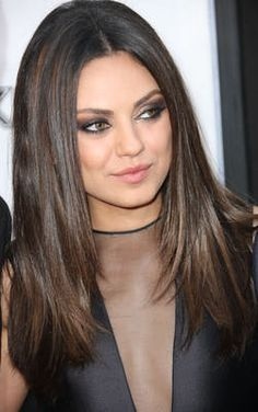 "Long hair creates the illusion of length in the face and the straight hair doesn't add body to the sides of the face. In fact, the curtain effect has a nice way of slimming Kunis's face. Note her center part. ""If you want to wear a center part, the way to make it work for a round face is to have hair a few inches past your shoulders with layers that hit at the jaw""."