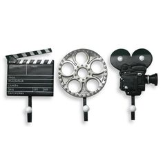 "Movie Plaque Hooks      These cool hooks shaped like a clapboard, film reel and old movie camera will be perfect to add to a movie-themed room or lend a whimsical touch to any decor. Each hook measures 7"" W x 12"" L."