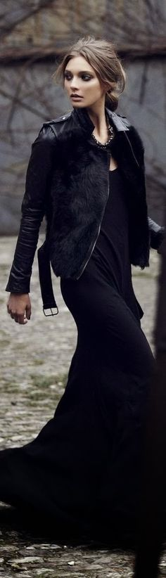 Street fashion black maxi dress and leather and fur coat.