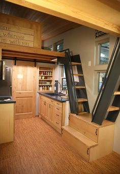 When your home is small, you can spend more on high-quality furniture and appliances, like this snazzy kitchen, all dressed up in wood! Get Up Close and Personal with Some of the Swankiest Tiny Homes on the Market - The Accent™ | Tiny Homes