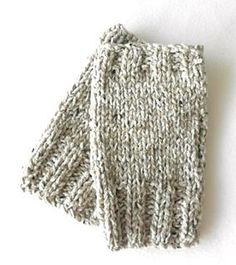 Knit on 2 needles with 2 strands of DK yarn held together these fingerless gloves are quick to make.