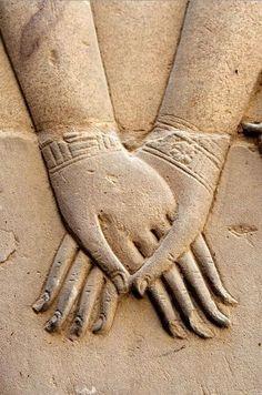 Hathor's Hand Holding Nefertari. Symbolizes the junction of the upper Egypt and Lower Egypt
