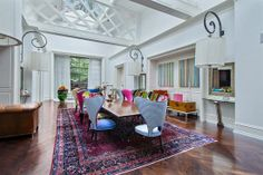 This dining room beautifully combines the traditional with the contemporary. The ordinary wooden table gets new life with the bright colored variety of unique chairs. Chicago, IL Coldwell Banker Residential Brokerage $2,795,000