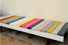 We could build wooden benches from scrap wood and brightly paint them like this for lecture seating.