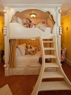 Gorgeous for a grandchildren room perhaps... in the far future!!!! The most beautiful bunk beds...seems like a fairytale!