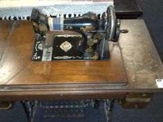Singer 128 on a treadle with a handcrank