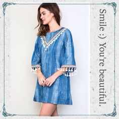 BOHO Denim Dress w/ Fringe - Love it! YES Please                                                 just in time for Spring and Summer              comfortable, simple, has fringe = awesome dress                                                                   brand new and sealed                                   70% cotton 30% poly April Spirit Dresses Mini