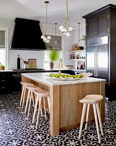 Easy-to-clean and durable enough for high-traffic areas, cement tiles are a top flooring choice in bustling restaurants. For the same reasons, they work well as flooring in other rooms of the home like the kitchen and bathrooms. Kitchen Cabinet Color Schemes, Two Tone Kitchen Cabinets, Painting Kitchen Cabinets, Kitchen Paint, Kitchen Colors, Kitchen Design, Kitchen Sets, Wood Cabinets, Painted Kitchen Island