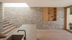 Al-Jawad Pike combines brick, concrete and timber for restrained London home extension