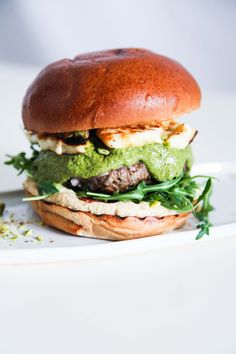 Lamb Burger with Halloumi. This super tasty lamb burger with halloumi and green herb sauce are a perfect solution for a super gourmet lunch or dinner. Slow Cooked Lamb Shanks, Braised Lamb Shanks, Lamb Recipes, Wrap Recipes, Healthy Recipes, Burger Recipes, Diet Recipes, Lamb Ragu, Grilled Lamb Chops
