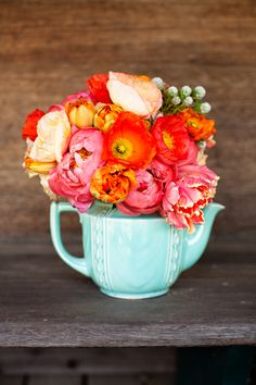 teal teapot container with orange, peach & yellow peonies and poppies ... I just love the combination!