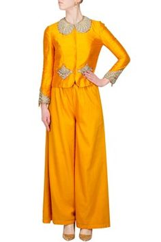 Featuring a silk golden yellow zardozi jacket with embroidery on neckline, waist and cuffs. It comes with cotton silk palazoes by AHARIN INDIA Shop now-www.carmaonlineshop.com