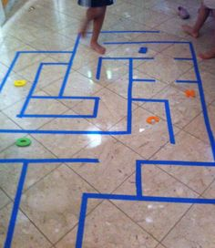 Use blue painter's tape to make a maze on the floor. Kick a bean bag through the maze to work on eye-foot coordination.