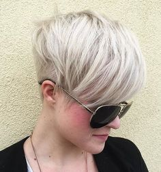 Silver Blonde Layered Pixie Undercut. If you are confused in trying to decide whether you want a softer style opposed to a rough, edgier look, do both! An undercut is the current trend in bringing out your inner bad girl while still maintaining the lady-like side of you.