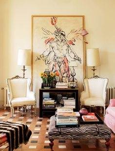 Love the scale if the Art, the placement of the furniture layered in front and the lamp clipped onto the frame in such an insouciant way...k...Carolina Herrera Jr.