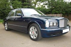 1999 T Bentley Arnage Red Label Look-alike.  Finished in Royal Blue with Saffron interior. Walnut veneers and French Navy carpets piped in Saffron. Only one owner from new. Only 68,000 miles with Full Service History. Totally unmarked and immaculate condition throughout. Only £22.950 Full Details: http://hanwells.net/bentley-select/arnage-select/1999-t-bentley-arnage-red-label-look-alike-in-royal-blue-22-950
