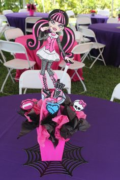 Themed centerpieces at a Monster High girl birthday party!  See more party ideas at CatchMyParty.com!
