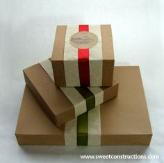 Boxes for cookie assortments - paper bands, cloth ribbon, and sticker on kraft boxes
