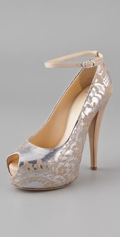 Me likes! (Floral lace overlay on metallic leather peep toe pumps.  YES PLEASE.)