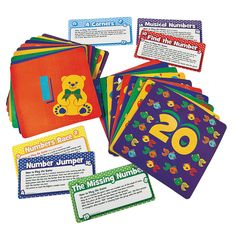 """26 Pc. Number Activity Mats - 20 pieces of 9"""" rubber mats (printed 1-20), with 6 cardboard instruction cards for different games (The Missing Number, Musical Numbers, Find the Number, 4 Corners, Numbers Race, and Number Jumper) - OrientalTrading.com"""