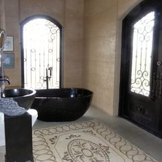 bathroom rammed earth with mosaic floor